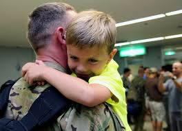 A child hugs his father